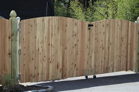 how to build a double swing wooden gate double swing wood fence gate spring loaded rollers to
