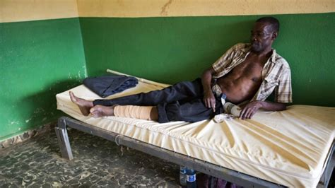 haitian men in bed haitians await aid help each other regain some normalcy