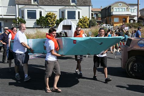 cardboard boat race fails bay area web design company wins cardboard boat race