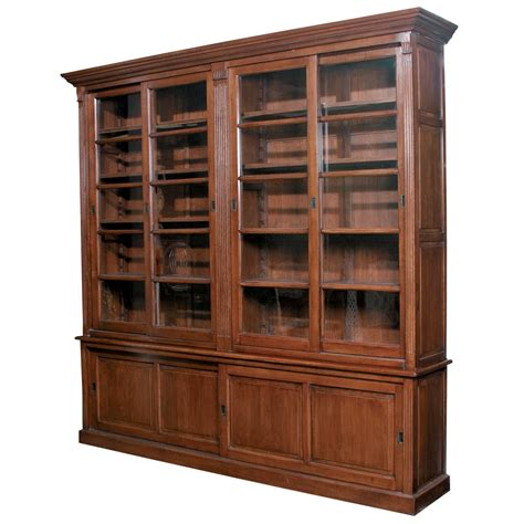 Large Bookcase With Glass Doors Large Brown Teak Wood Bookcase With Glass Doors Also Hutch Underneath To Store Your Book