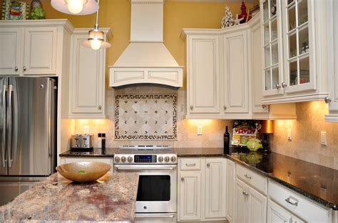 backsplash for yellow kitchen white cabinets dark granite stainless steel appliances
