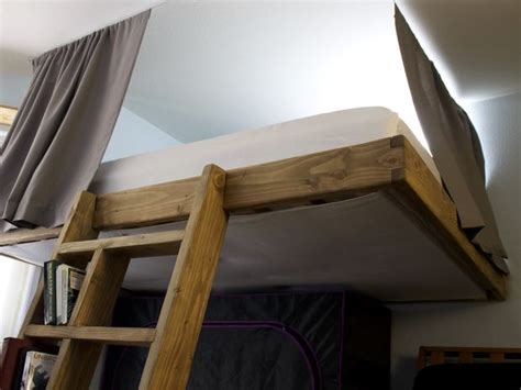 partially freestanding loft bed    steps