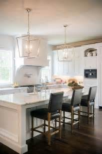 Light Fixtures Over Kitchen Island by Stunning White Kitchen With Silver Lanterns And Dark