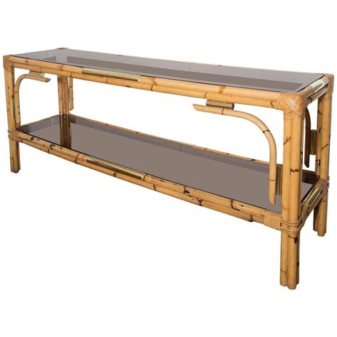 bamboo console table with two tinted glass shelves and
