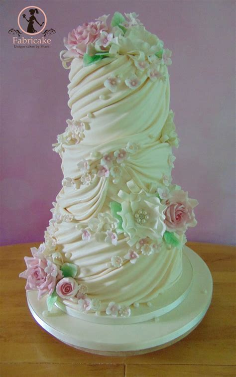 wedding cake drapes flowers pearls and drapes wedding cake wedding cake