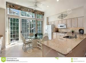 Cabinet Kitchen Island kitchen with sliding doors to patio royalty free stock