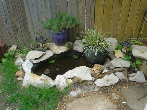 small backyard koi pond small koi pond in our backyard our small koi pond we