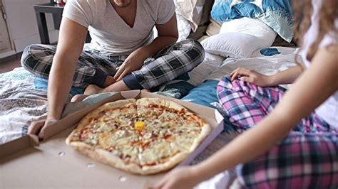 pizza in bed couple eating pizza in bed stock footage video getty images