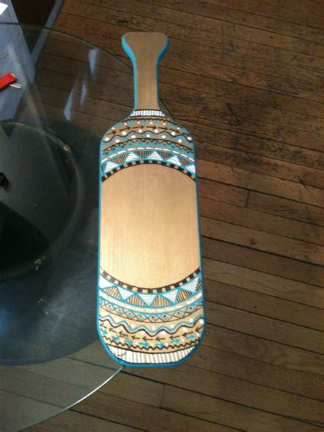 Tribal Pattern Paddles | gold background hand painted tribal design paddles