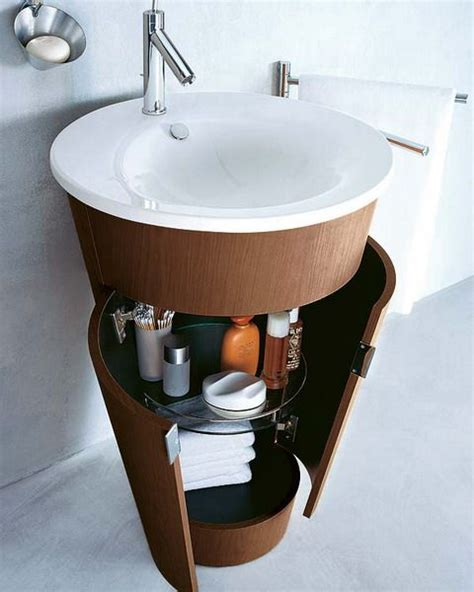 small bathroom sink ideas circular pedestal sink with closed storage underneath for small spaces pedestal sink storage