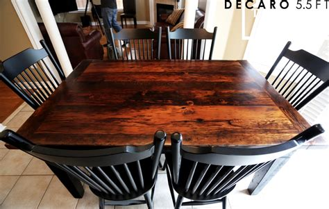 reclaimed wood table with black chairs georgetown reclaimed wood harvest table with black base