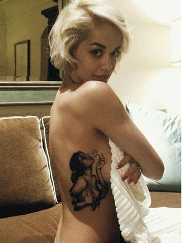 rita ora tattoo on ribs meaning cara delevingne arm tattoo rita ora tattoo on ribcage