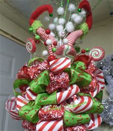 elf legs christmas tree topper a well the ribbon and