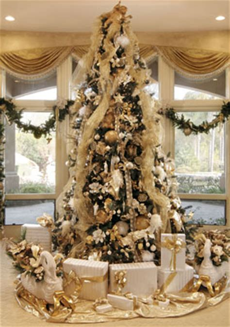 white and gold decorated trees ten steps to a spectacular tree gaston alive