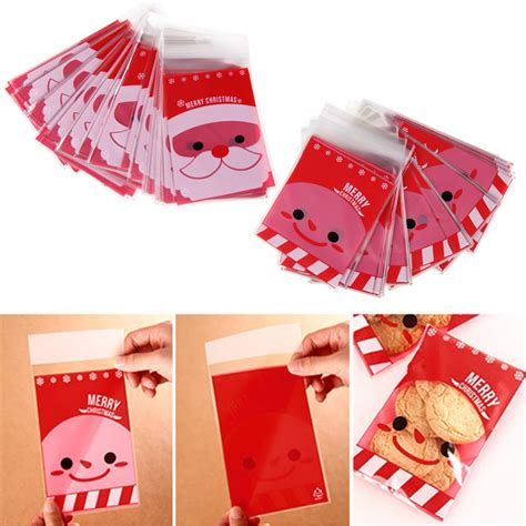 Cellophane Gift Bags Uk - 100pcs merry santa cellophane cello bags