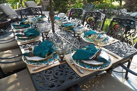 patio table set for a barbeque mediterranean patio