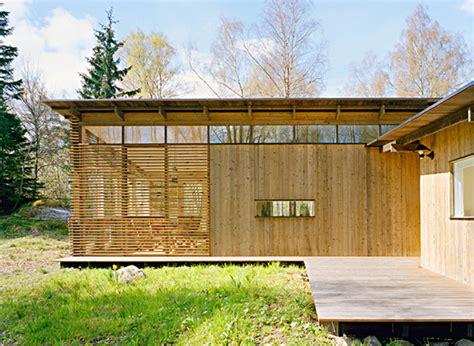 award winning red cedar home resonates with treed summer cabin design award winning wood house by wrb