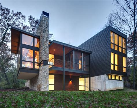 a new contemporary house in wisconsin is covered in
