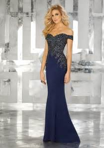 form fitting special occasion gown with beaded embroidery