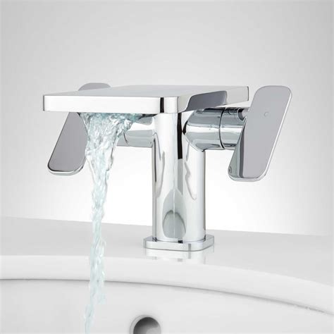 Single Sink With Two Faucets by Wyatt Single Dual Handle Waterfall Bathroom Faucet