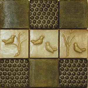 hand sculpted finch bubble and reed ceramic tiles