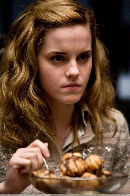 emma watson eating glaring while eating cream puff she must have to be very