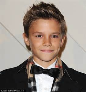 how should an 11year boys hair look like romeo beckham steals the spotlight from parents david and