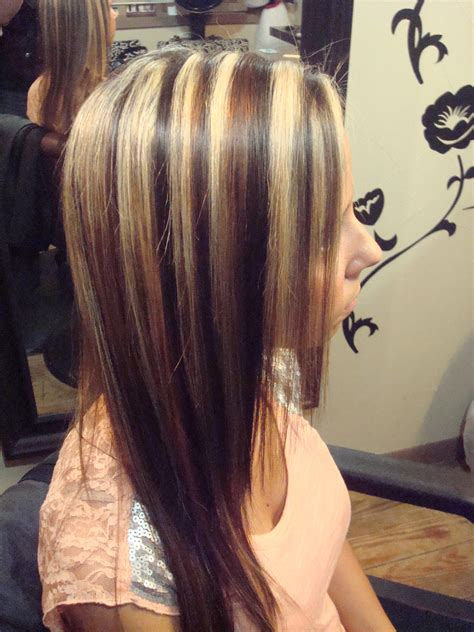 short brown hair with chunky blond caramel lowlights in a dark brown bob short hairstyle 2013