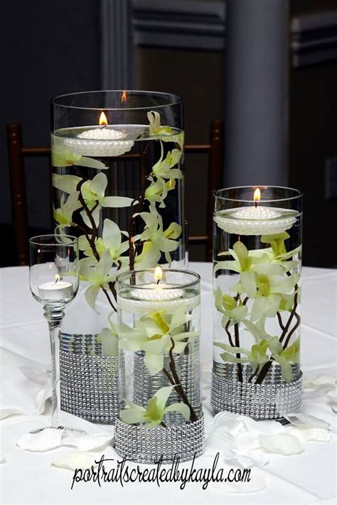 Cylinder Vases With Floating Candles And Flowers by Three Level Clear Cylinder Vases With Floating Flowers And