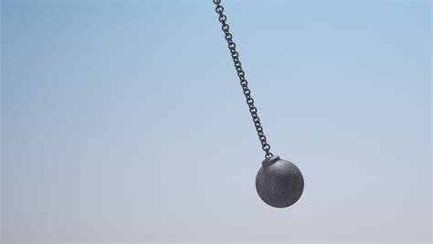 metal swinging balls a regular metal wrecking ball attached to a chain swinging
