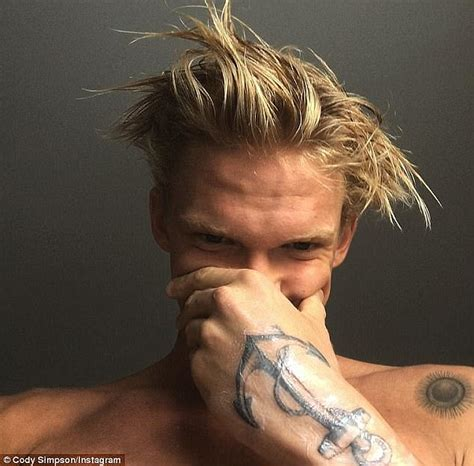 cody simpson tattoo shows his buff on a shirtless jog