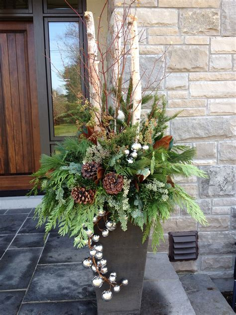 christmas decorating huge stone urns in front of entrance outdoor urn by carla mcgillivray by carla urn