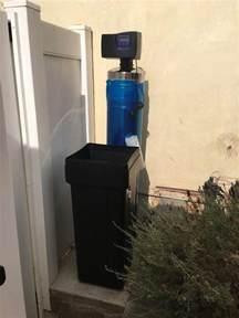outdoor water softener installed on home in manhattan