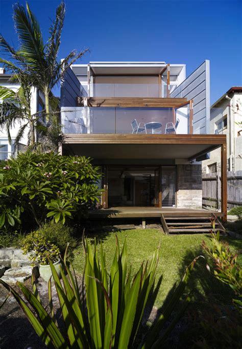 Modern beach house renovation zinc roof clad home improvement