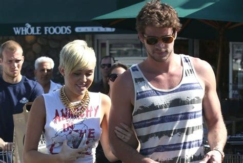 liam hemsworth tattoo roundup liam hemsworth and miley cyrus now