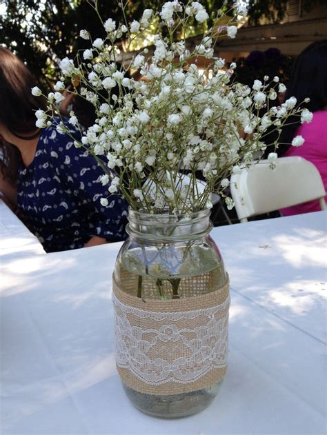 Baby's breath centerpiece in a Mason Jar, wrapped in