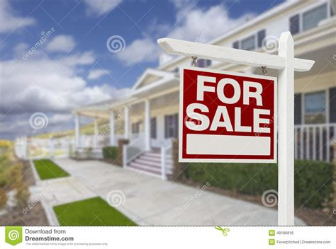 home for sale real estate sign and house stock photo
