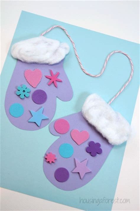 Winter Paper Craft - winter mitten craft for preschoolers housing a forest