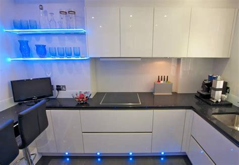 Blue Led Kitchen Lights White Gloss Handless Kitchen In Acrylic Finish With Quartz Worktop And Blue Led Accent Lighting