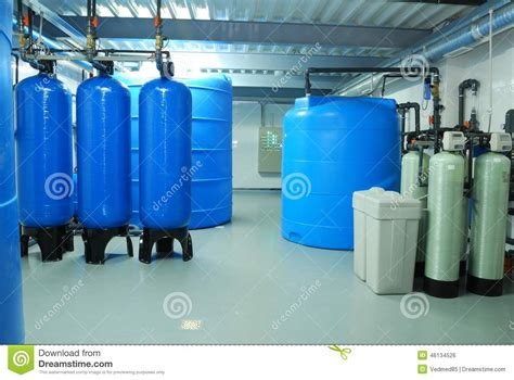 What Industry Is Plumbing by Industry Pipes Taps And Blue Barrel Stock Photo
