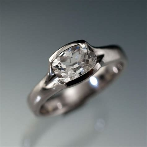 lab created cushion white sapphire fold solitaire