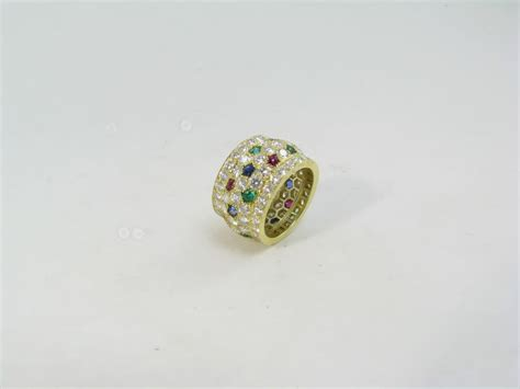 cartier chic gold ruby emerald and sapphire ring