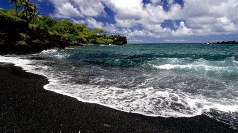 beach with black sand top 10 black sand beaches toptenz net