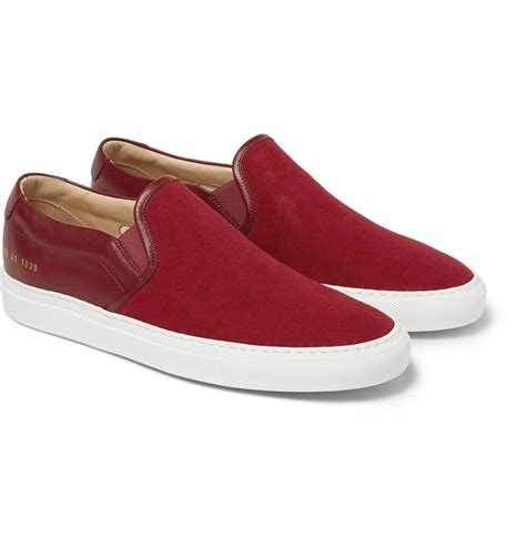 on sneakers common projects canvas and leather slip on sneakers in