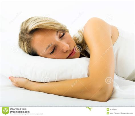 girl sleeping with white pillow in bed stock photo image