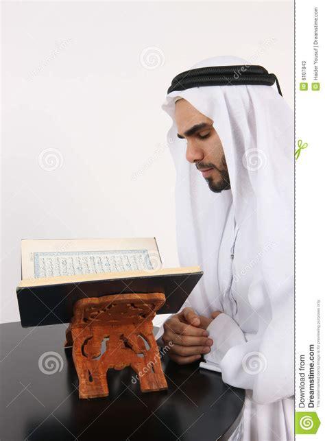 arab man reading  quran stock image image  muslim