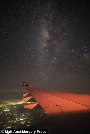 dazzling photos of milky way taken through plane window