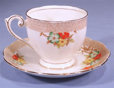 Floral Pattern Bone China Tea Cup And Saucer bell china enamelled floral vintage bone china tea cup and saucer pattern 4280 collectable