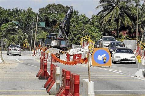 new year road closure malaysia construction project causes jam along teluk intan batak