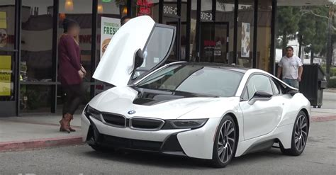 bmw i8 gold bmw i8 gold digger prank proves girls like doors that go